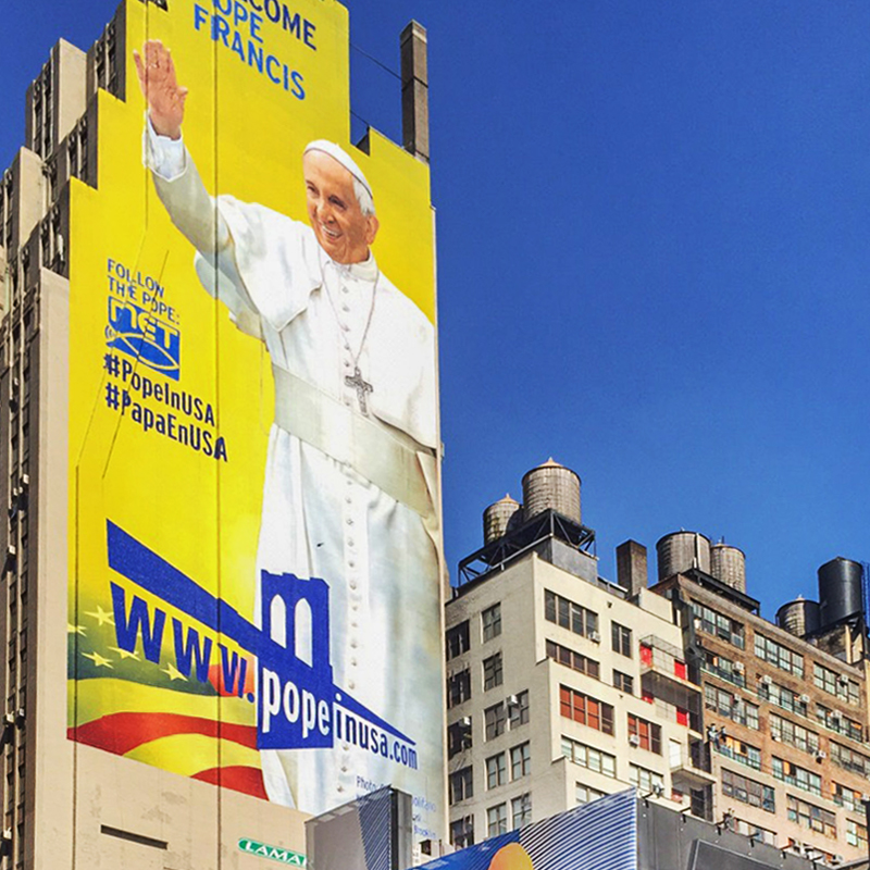 Large mural of Pope Francis on side of building in NYC