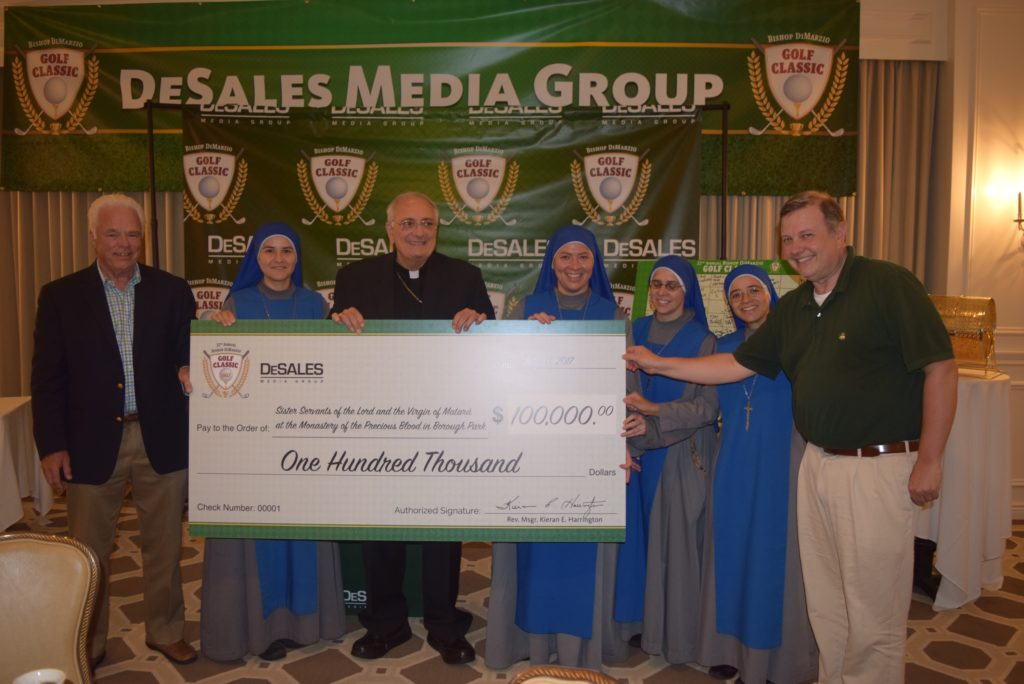 Bishop DiMarzio , four nuns and two men with Oversized Check