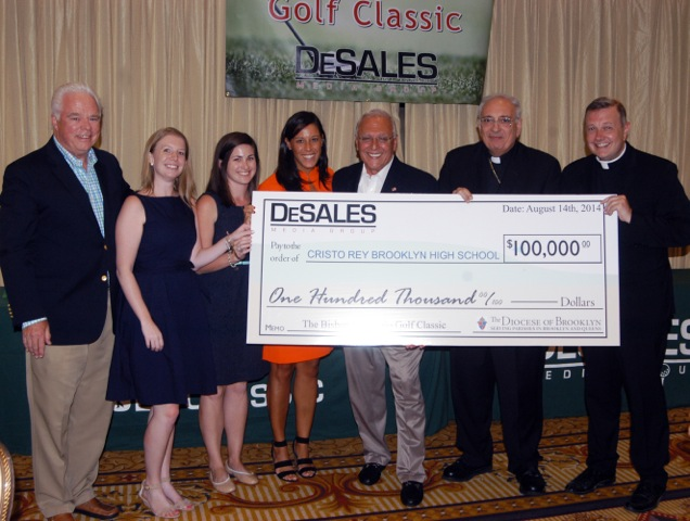 Two priests three women and two men with large oversized check