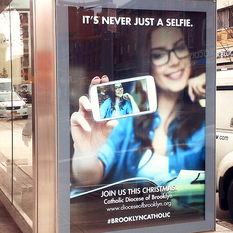 Ad for Brooklyn Catholic Church on a Bus stop