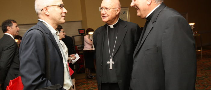 Bisiop Dimarzio and priest talking with a man