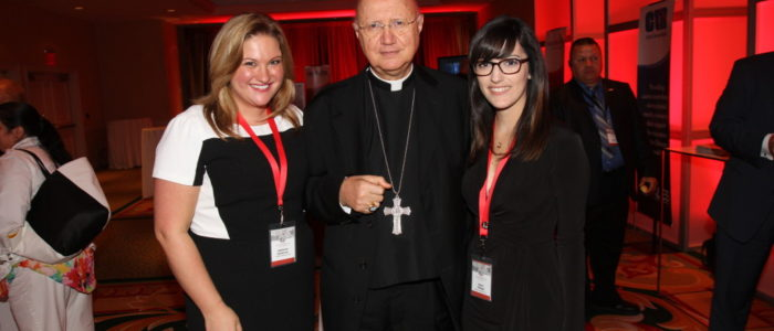 A priest and two women