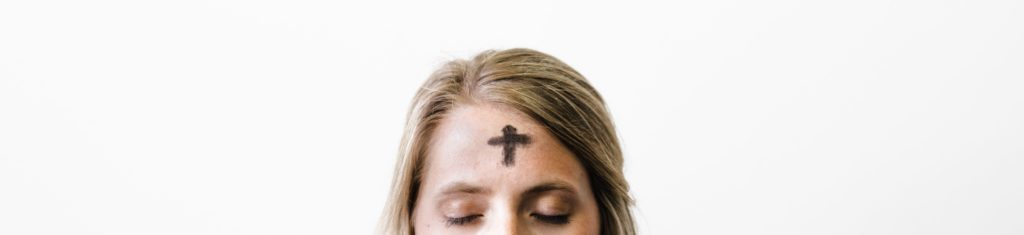 A woman with a cross of ashes on her forehead