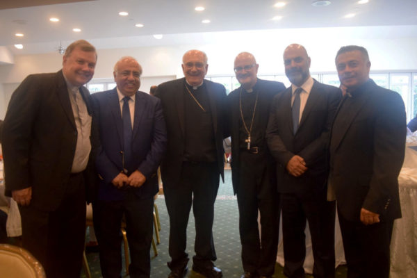 Bishop DiMarzio and Monsignor Harrington welcome Mr. Jacques El Kallassi and Bishop Gregory Mansour.
