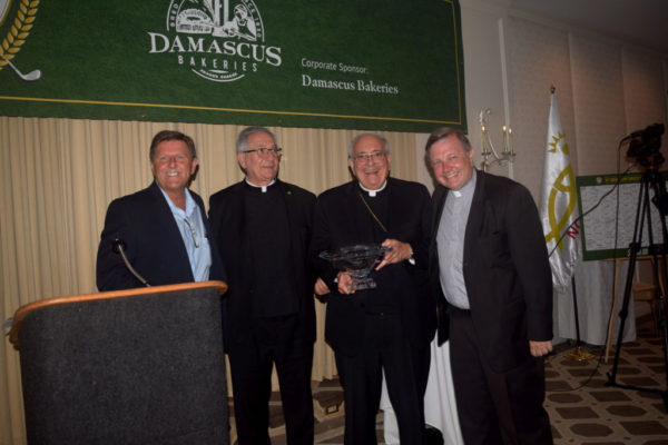 Bishop DiMarzio, Monsignor Harrington and Bill Maier prepare to give Monsignor LoPinto the Clergyman of The Year Award.